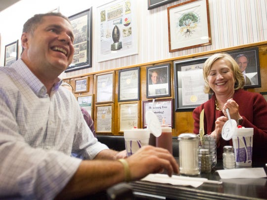 Former Secretary of State Hillary Clinton enjoys a pie shake with Democratic Senate candidate Rep. Bruce Braley during a brief stop at Hamburg Inn on Wednesday, Oct. 29, 2014.  David Scrivner / Iowa City Press-Citizen