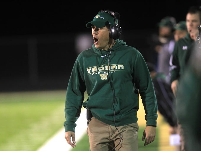 West High head coach Garret Hartwig calls to his players