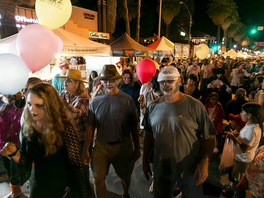 The public attend Halloween Spook-tacular and Zombie Walk at downtown Palm Springs VillageFest, Thursday evening, October 30, 2014.
