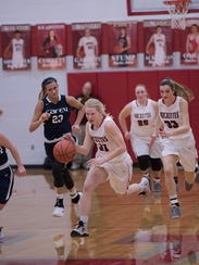 Kyleigh Brown drives down the court.
