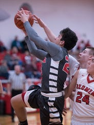 Buckeye Central's Dalton Sheaffer takes the ball to the hoop.