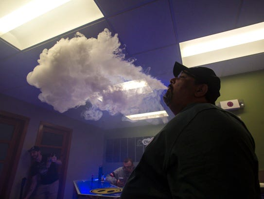 Don Miller, owner of Champ Vapes in Burlington, exhales
