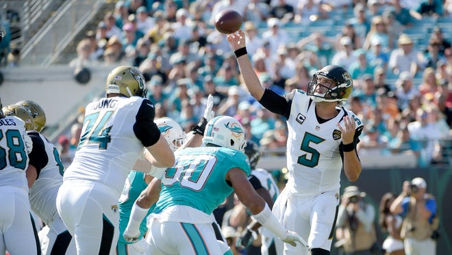 Jacksonville Jaguars quarterback Blake Bortles throws a pass against the Miami Dolphins during the first half of an NFL football game in Jacksonville, Fla., Sunday, Sept. 20, 2015.