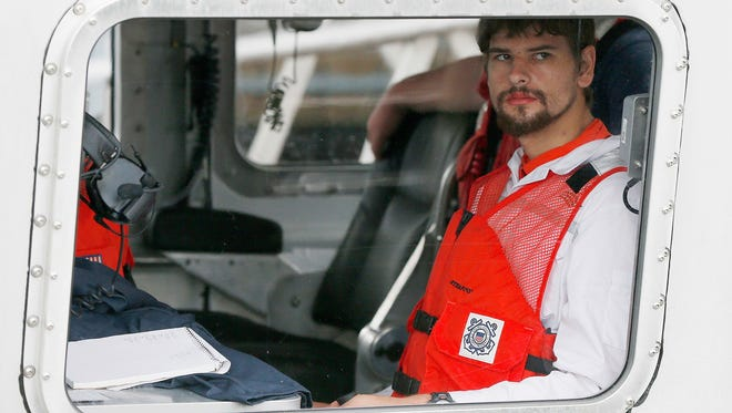Nathan Carman arrives in a small boat at the US Coast Guard station in Boston, Tuesday, Sept. 27, 2016. Carman spent a week at sea in a life raft before being rescued by a passing freighter.