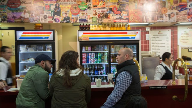 Customers talking on Saturday at El Artesano Restaurant, a Cuban meeting spot for decades on Bergenline Avenue in Union City.