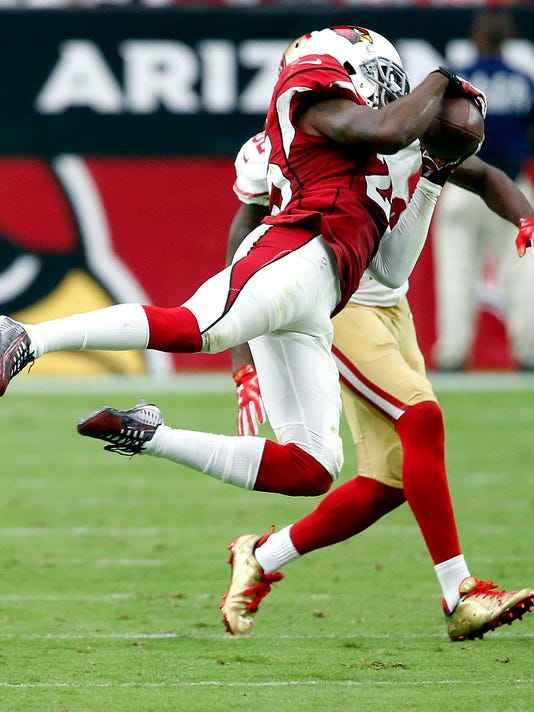 Arizona Cardinals cornerback Jerraud Powers (25) intercepts a pass intended for Torrey Smith (82) during the second half of an NFL football game, Sunday, Sept. 27, 2015, in Glendale, Ariz.  (AP Photo/Ross D. Franklin)