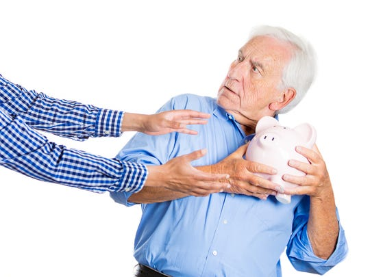 A surprised senior man holding on to his greedy as outstretched arms reach it.