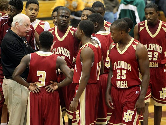 Coach Al Blizzard and his Florida High team gather during a timeout of a 2012 game.