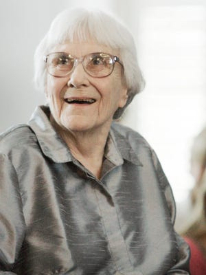 Author Harper Lee smiles during an August 2007 ceremony honoring the four new members of the Alabama Academy of Honor at the Capitol in Montgomery, Ala.