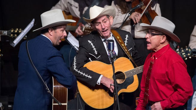 From left, Hugh Harris, D. L. Menard and Pope Huval perform at the 2015 Tribute to Hank Williams at the Liberty Theater in EUnice