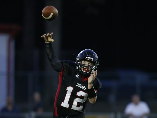 Jackson Memorial quarterback AJ Tolmachewich throws