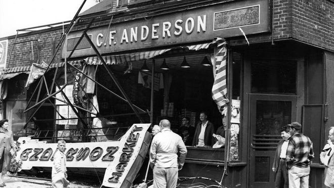 FILE - In this Aug. 31, 1954, photo, the large sign on the front of the C. F. Anderson store at East Chestnut and Main streets in Brockton was a victim of Hurricane Carol.