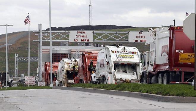 Trucks line up at the Rumpke landfill off Colerain Aveune and Struble Road in Colerain Township. For years now, Rumpke has been challenging the township's right to stop it from expanding the landfill eastward. The two parties are making their cases in court this week.