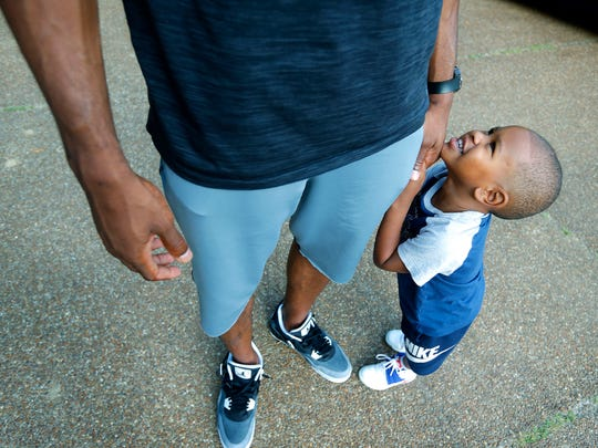 "August 7, 2016 - Taylor Young, 3, tugs on his dad, NBA player Thaddeus Young's arm while talking to him about playing after getting home from an outing. ""I've got two kids and a wife, what more do I need?"" Young said while talking about his frugality and careful investments with his earnings."
