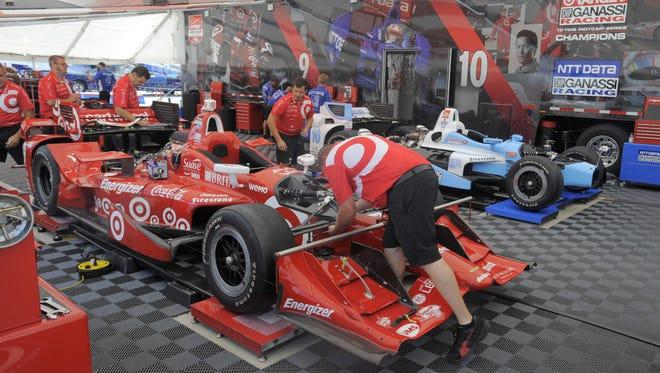 Crew members work on Scott Dixon's Chip Ganassi Racing car in preparation for this weekend's Dual in Detroit on Belle Isle.