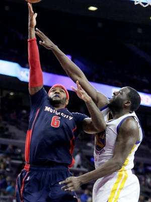 Detroit Pistons' Josh Smith (6) goes to the basket against Golden State Warriors' Draymond Green during the second half on Nov. 30 at the Palace.