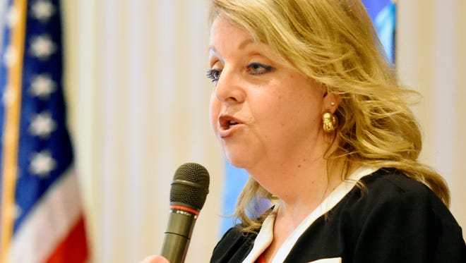 York County District Attorney candidate Jonelle Eshbach gives her opening statement during a debate with fellow Republican candidate Dave Sunday during the York Rotary Club meeting at Country Club of York in Spring Garden Township, Wednesday, April 12, 2017. Dawn J. Sagert photo