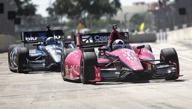 Dario  Franchitti races down the straight away in front of Graham Rahal during the Grand Prix Of Houston on Sunday.