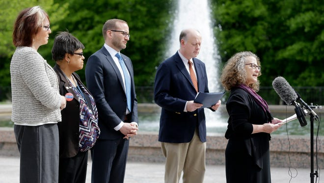 Hedy Weinberg, right, executive director of the ACLU of Tennessee, speaks at the Legislative Plaza regarding a Tennessee transgender bathroom bill Wednesday, April 13, 2016, in Nashville, Tenn. The sponsor of the bill told a Senate committee Tuesday that he has to consider a state attorney general's opinion before going forward. (AP Photo/Mark Humphrey)