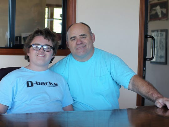 Joshua Brown, left, and his father, Robert Brown, of Redding.