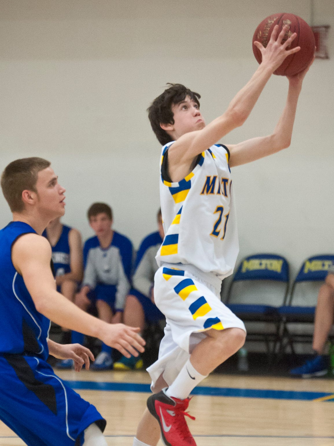 Milton's Ryan Brown, right, drives for a layup in front