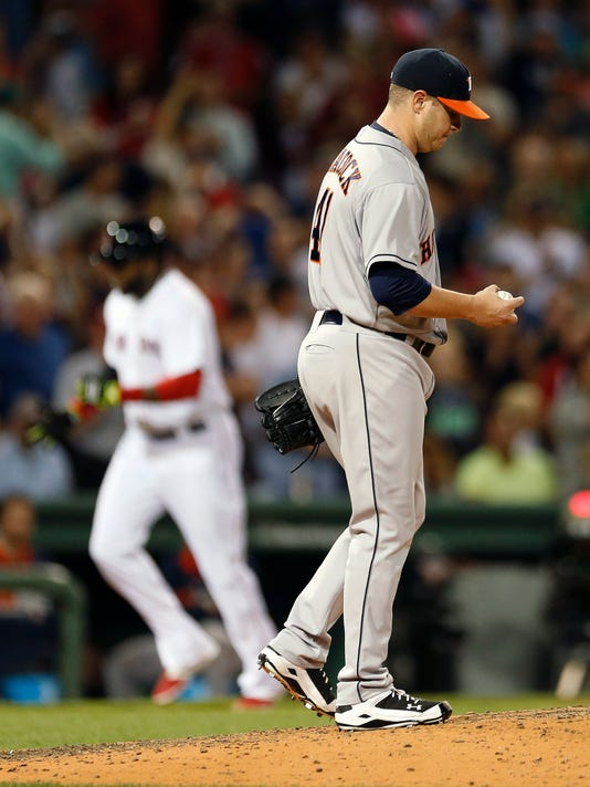 Houston Astros' Brad Peacock stands on the mound as Boston Red Sox's David Ortiz, left, rounds third base on a two-run home run during the fifth inning of a baseball game in Boston, Saturday, Aug. 16, 2014. (AP Photo/Michael Dwyer)