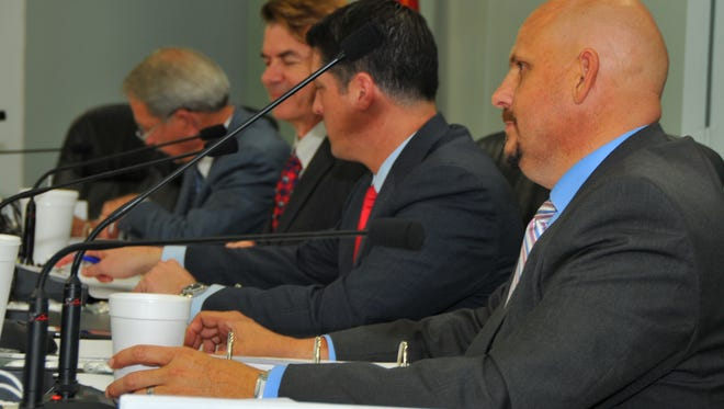 Members of the Brevard County delegation to the Florida Legislature listen to constituents during last year's delegation meeting. From left are Rep. Tom Goodson, Sen. Thad Altman, Rep. Steve Crisafulli and Rep. Ritch Workman.