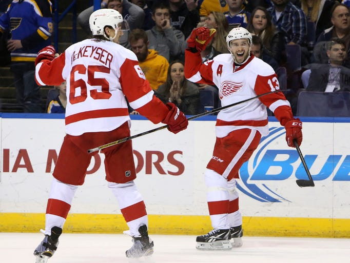 Red Wings center Pavel Datsyuk, right, celebrates with