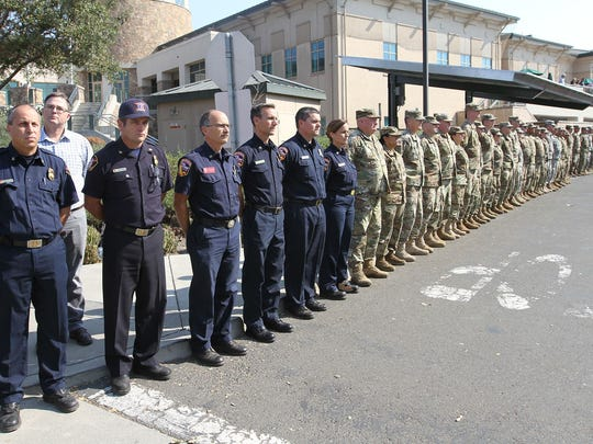 Soldiers from the 49th Military Police Brigade and California Department of Forestry and Fire Protection (CAL FIRE) personnel line a driveway Oct. 18 at the Napa County Sheriff's Department prior to rendering a final tribute to Garrett Paiz, a 38-year-old volunteer firefighter, who died wile battling the Northern California wildfires.
