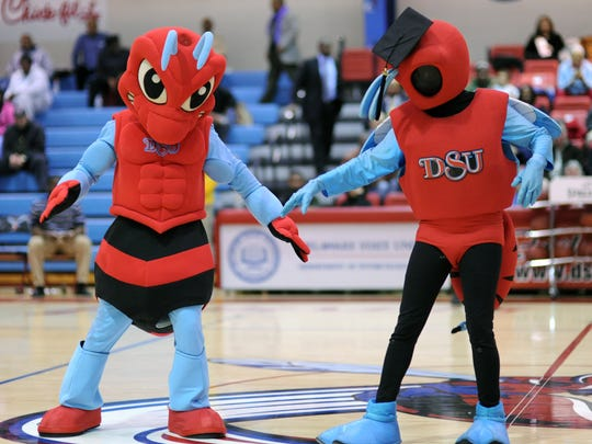 Buzz (right), the former Delaware State Hornet mascot,  teaches his replacement, Too-Fly, dance moves at Delaware State University in 2012.