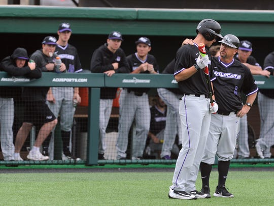 Abilene Christian University Head Baseball Coach Britt Bonneau speaks with batter Mark Pearson during Sunday's game against Michigan State University at ACU. The Wildcats lost, 14-5.