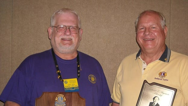 Richmond Lions Club members Dudley Fetzer (left) and Jack Buckland received awards for outstanding service during a recent club meeting.