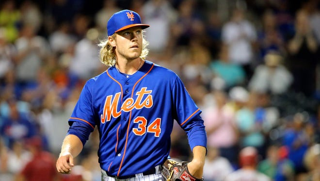 New York Mets starting pitcher Noah Syndergaard (34) heads to the dugout during the eighth inning against the Arizona Diamondbacks at Citi Field.