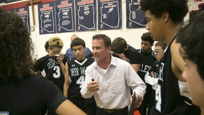 Deer Valley head boys basketball coach Jed Dunn talks to the team during a timeout during the boys basketball game against Catalina Foothills at Scottsdale Christian Academy on Friday, Dec. 30, 2016.