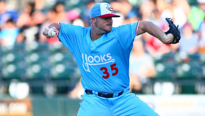 """Hooks' Keegan Yuhl wears the Hooks """"FauxBack"""" uniform last year. The promotion was so popular the uniforms will be the Hooks alternate jerseys this season and will be worn every Friday."""