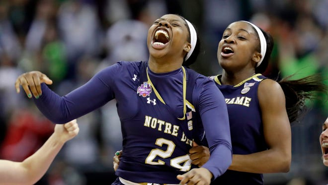 Notre Dame's Arike Ogunbowale, left, is congratulated by teammate Jackie Young after sinking a 3-point basket to defeat Mississippi State 61-58 in the final of the women's NCAA Final Four college basketball tournament, Sunday, April 1, 2018, in Columbus, Ohio. (AP Photo/Tony Dejak)