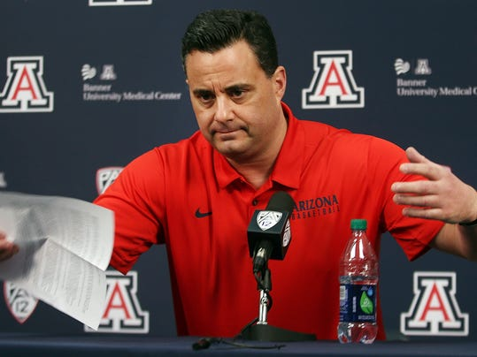 Arizona NCAA college basketball coach Sean Miller gestures during a press conference in Tucson, Ariz., Thursday, March 1, 2018.  Miller vehemently shot down a report claiming he discussed a six-figure payment to a top recruit and said he looks forward to continuing to coach the team. ESPN reported last Friday, using anonymous sources, that the FBI had Miller on a wiretap discussing a $100,000 payment to Wildcats freshman Deandre Ayton to attend the school.  (Mike Christy/Arizona Daily Star via AP)