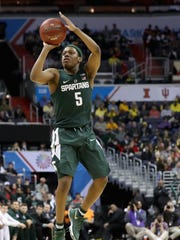 Cassius Winston of Michigan State puts up a shot against