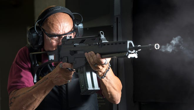 John Middleton fires an HK G36 automatic rifle at Caswells Shooting Range in Mesa. Arizona is the No. 1 state for gun owners, according to  Guns & Ammo magazine.