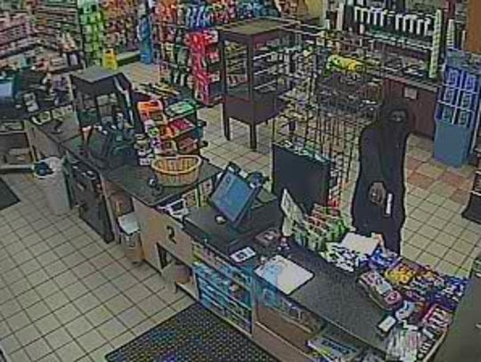 Police are searching for the male suspect in an armed