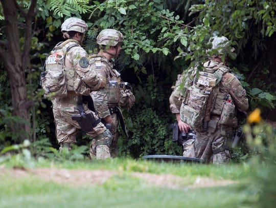 Police in tactical gear responded to a standoff in