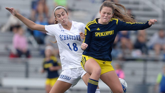 Spencerport sophomore Erin Coykendall, defended here by Elisabeth Stowell, leads the Rangers with six goals and has 18 over the past two seasons.