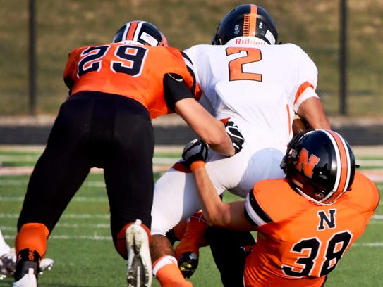 Dearborn'sYouseph Saad (2) gets corralled by Northville