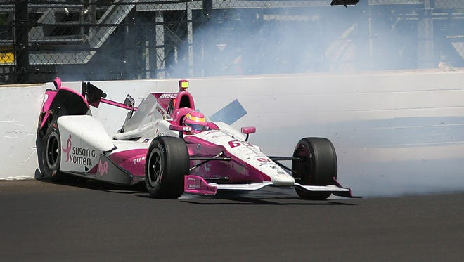 IndyCar driver Pippa Mann (63) hits the wall coming out of turn four during Carb Day for the 100th running of the Indianapolis 500 Thursday, May 27, 2016, afternoon at the Indianapolis Motor Speedway during Carb Day for the 100th running of the Indianapolis 500 Thursday, May 27, 2016, afternoon at the Indianapolis Motor Speedway