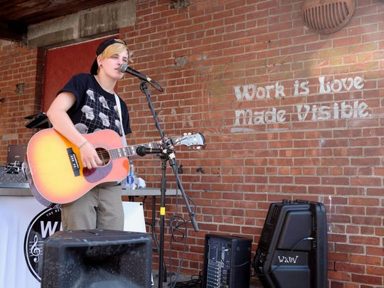 Sadie Bolger plays at the ArtsRiot Truck Stop on July