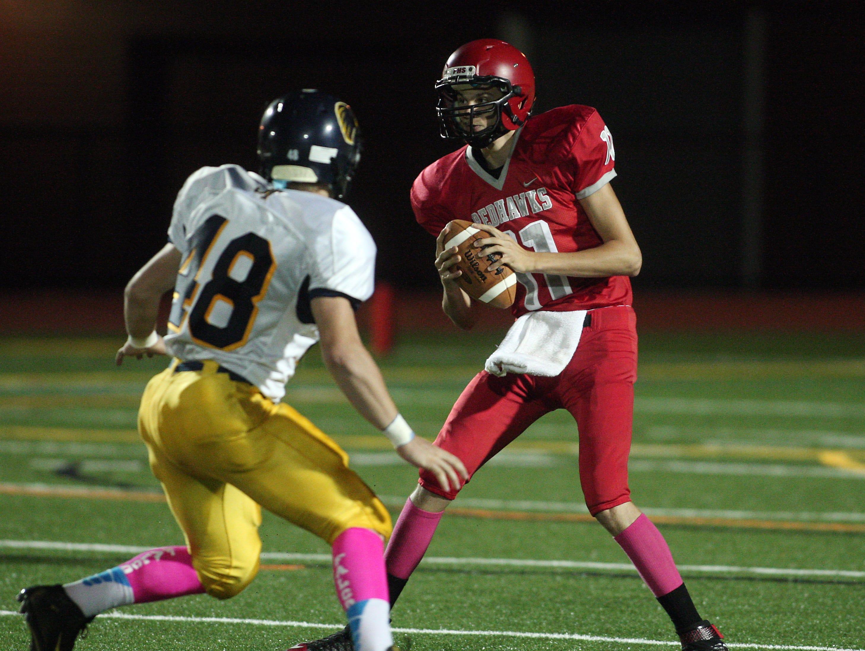 Jefferson Aidan Sinisgalli looks to sack Parsippany quarterback Nick Zimmerman in a Friday night football matchup. October 9, 2015, Parsippany, NJ.