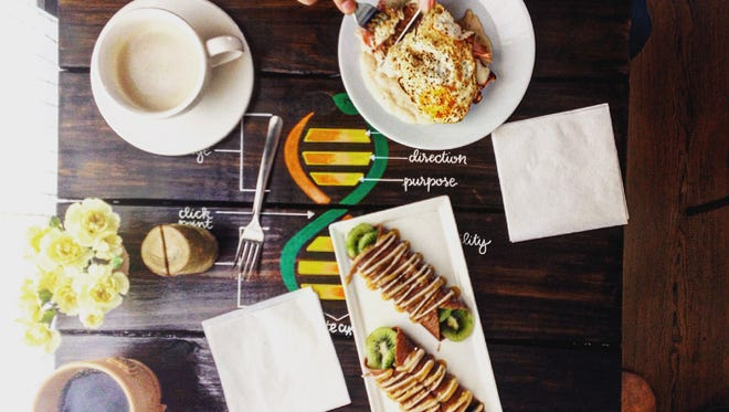 Featured in this photo at Tribe Collective is the Mortar & Pestle gluten-free croque Madame, Emerge raw crepe-full, and Reve short and sweet and drip coffee.
