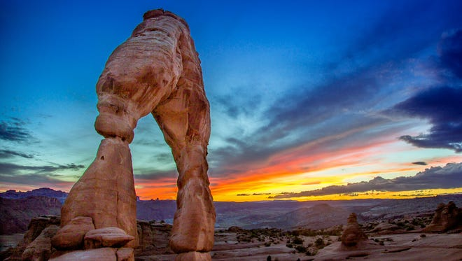 """Standing 65 feet tall, Delicate Arch is the most famous sandstone formation in Arches National Park. Referred to simply as """"the arch"""" by many newly arriving visitors, Delicate has an allure that is hard to explain but impossible to deny."""