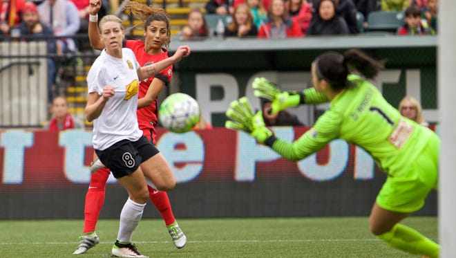 Flash defender Alanna Kennedy (in white) and goalkeeper Sabrina D'Angelo help keep this shot out of the goal in Sunday night's NWSL semifinals in Portland, Oregon. WNY won 4-3 in overtime.