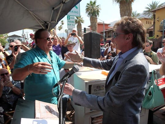 """Barry Manilow and Harry Wayne Casey, the lead singer for KC and the Sunshine Band, seen here during a Palm Springs Walk of Stars star unveiling ceremony for KC and the Sunshine Band in 2013 are part of """"A Capital Fourth 2015"""" airing Saturday at 8 p.m. on PBS SoCal."""